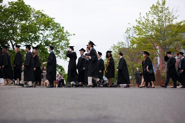05/22/2016 - Medford/Somerville, Mass. - Students cross Packard Avenue on the way to the Phase I ceremony of Tufts University's 160th Commencement on Sunday, May 22, 2016. (Matt Healey for Tufts University)