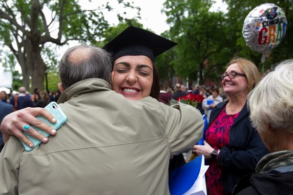 05/22/2016 - Medford/Somerville, Mass. - Flora Lucia Jackson Cardoni gets a hug from grandfather Bernie Ledermann after Phase 1 of Tufts University's 160th Commencement on Sunday, May 22, 2016. (Matt Healey for Tufts University)