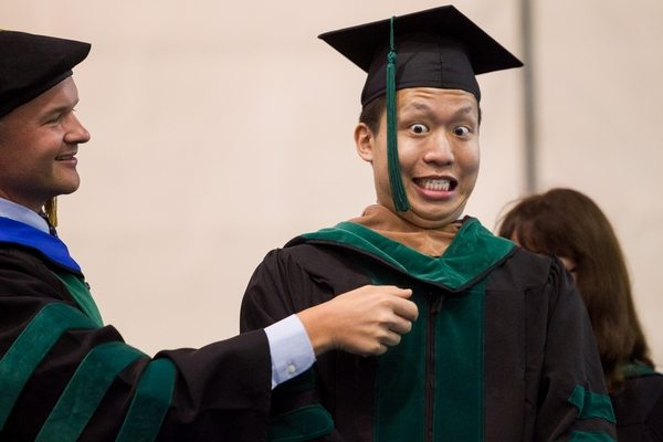 05/22/2016 - Medford/Somerville, Mass. - Dr. Ethan Tseng reacts as he is robed at the Tufts University School of Medicine Phase II  ceremony in Gantcher Center during Tufts University's 160th Commencement on Sunday, May 22, 2016. (Matthew Healey for Tufts University)