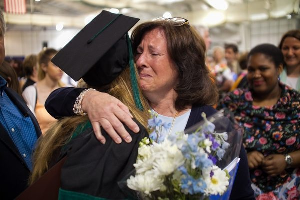 05/22/2016 - Medford/Somerville, Mass. - Darlene Manella (L) gives a hug to her daughter Haley Manella, MD, after the Tufts University School of Medicine Phase II  ceremony in Gantcher Center during Tufts University's 160th Commencement on Sunday, May 22, 2016. (Matthew Healey for Tufts University)