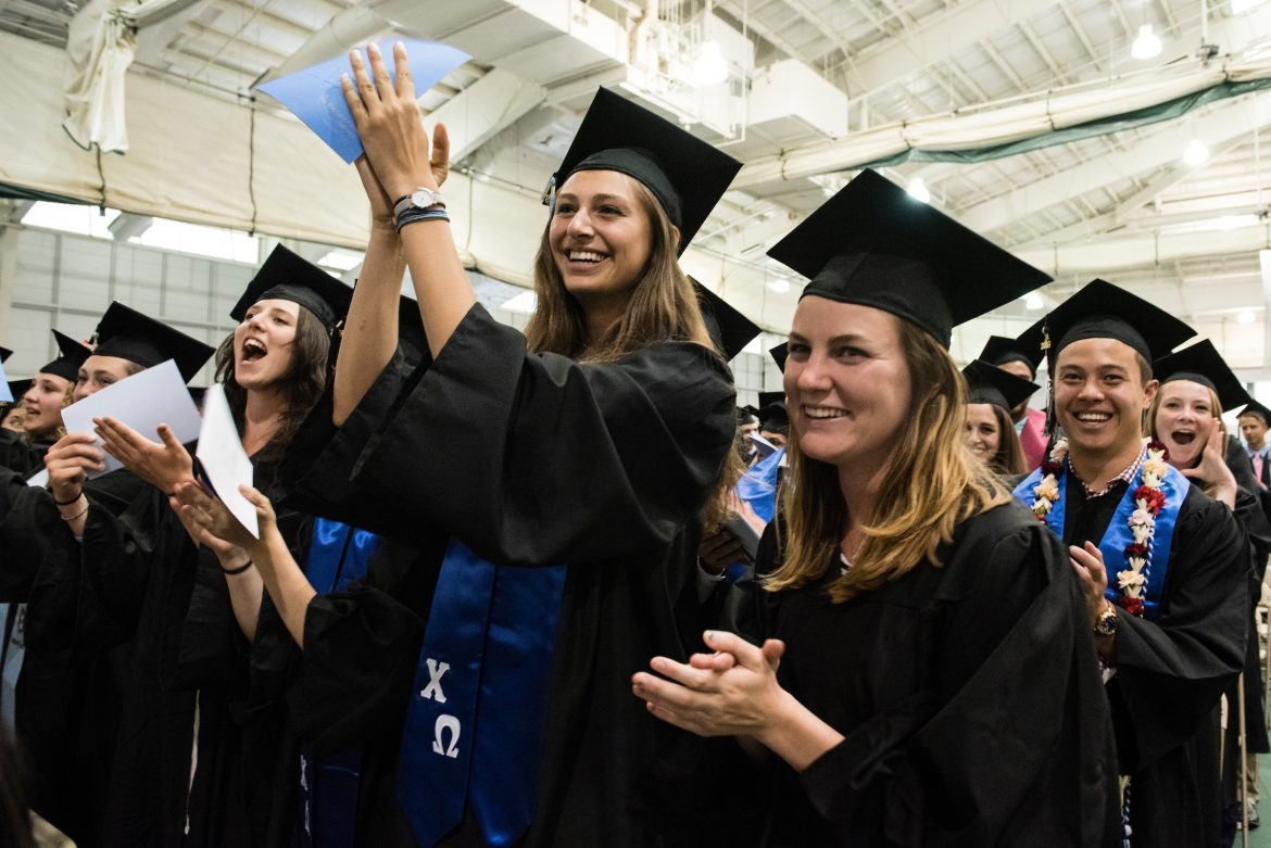 05/21/2016 - Medford/Somerville, Mass. - Graduating members of the class of 2016 can't resist dancing in their seats as Francis Appeadu-Mensah, A16, leads them in song during the Baccalaureate Service on the eve of Tufts University's 160th Commencement on Saturday, May 21, 2016. (Alonso Nichols/Tufts University)