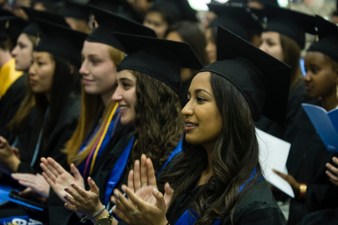 05/21/2016 - Medford/Somerville, Mass. - Graduating seniors of the class of 2016 react to Wendell Phillips speaker Sharad Sagar, A16, during the Baccalaureate Service on the eve of Tufts University's 160th Commencement on Saturday, May 21, 2016. (Alonso Nichols/Tufts University)